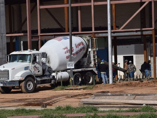 Concrete is poured Tuesday as part of the renovation work taking place at the Rapides Parish Coliseum.