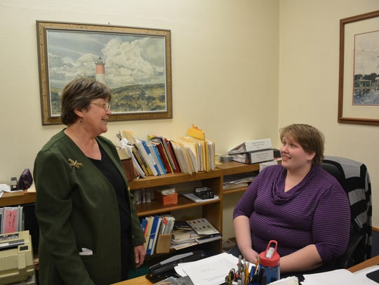 Rita Schiesser, left, who is retiring as director of