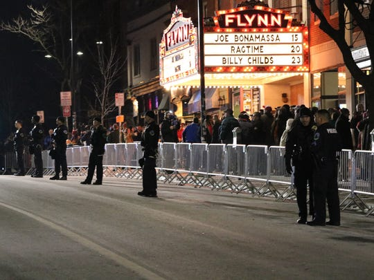 Burlington police patrol Main Street in front of the Flynn Center prior to the Donald Trump rally Jan. 7