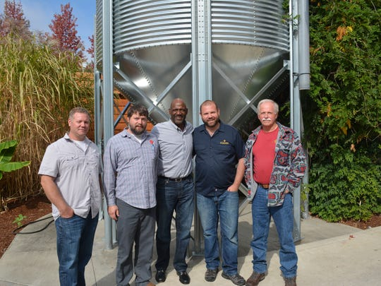 Terry Porter, center, poses with Michael, Matt, Nick and Lee Radtke at Gilgamesh Brewing.