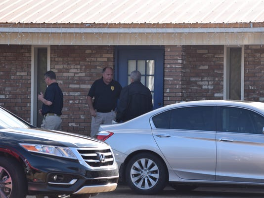Law enforcement officials are investigating a body found at 810 Main Street in Pineville.