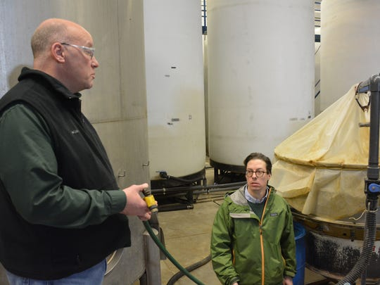 Fritz (left) and Hans Dramm of the Dramm Corp. discuss how they will move some of the 12,500-gallon tanks they currently use into the new space at their Algoma plant.
