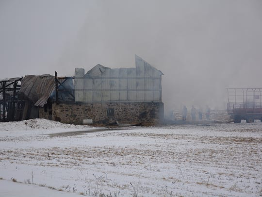 A six-alarm fire destroyed an 1800s barn off County