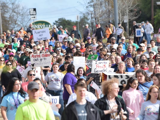 The March of Life Walk heads from Louisiana College in Pineville to Alexandria. The walk started at Louisiana College and ended at the amphitheater in downtown Alexandria.