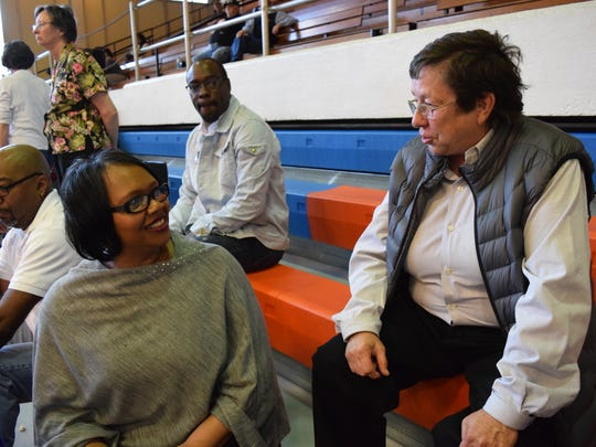 Pam Jones (left), sister of the late Louisiana College women's basketball coach Janice Joseph-Richard, talks to Deborah Marzula who coached Joseph-Richard as student at Peabody Magnet High School. Joseph-Richard was honored during a halftime ceremony for her upcoming induction into the Louisiana Sports Hall of Fame.