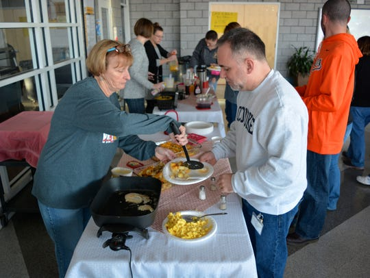 Pocomoke High School staff is served breakfast during