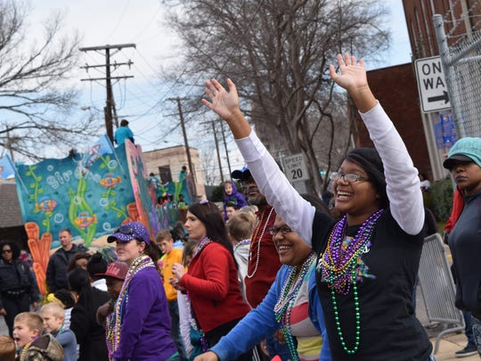 Lalasia Richard (right) and Antanea Thomas look for throws from a passing float at the Children's Mardi Gras Parade Saturday in downtown Alexandria.