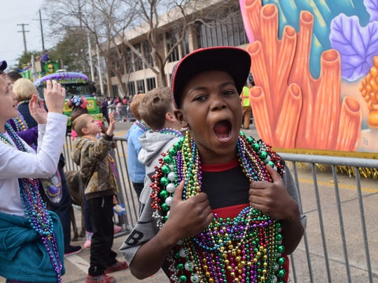 Amahri Jackson is excited about the beads and other throws he caught at the Children's Mardi Gras Parade Saturday in downtown Alexandria.