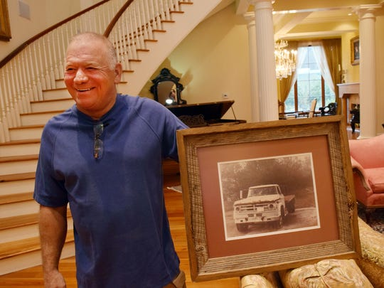 Businessman Aaron Slayter Sr., created the Maison Bonne Vive (ÒThe Good LifeÓ), a 20,000-square-foot home located at 2019 Horseshoe Drive in Alexandria. He shows a photo of the first truck he owned that hung in the bathroom of the master suite.