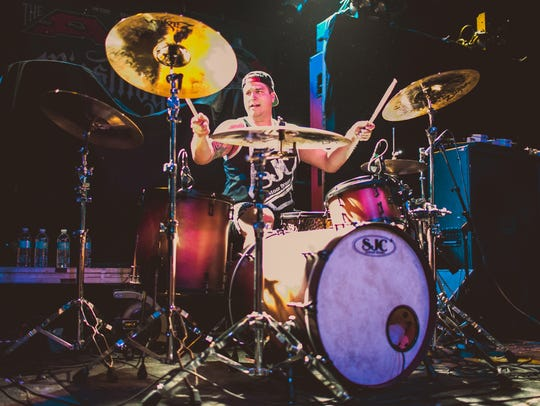 Andrew Tkaczyk, a Charlotte native and the drummer
