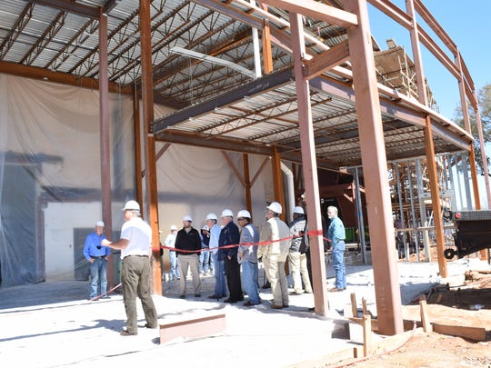 Bill Tudor (left foreground) of Alliance Design Group talks about the progress of the Rapides Parish Coliseum renovation project Friday while conducting a tour for police jurors and others.