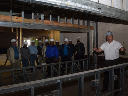 Bill Tudor (far right) of Alliance Design Group, which is overseeing the Rapides Parish Coliseum renovation project, shows one of the concession stand areas that can be opened on two sides. Tudor conducted a tour of the Coliseum for police jurors, Coliseum Authority members and others Friday.