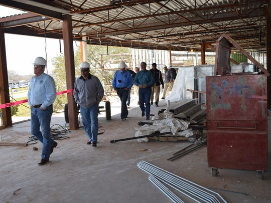Participants in a tour of the Rapides Parish Coliseum walk through a construction area Friday. The $22.9 million renovation of the Coliseum is at the halfway point.