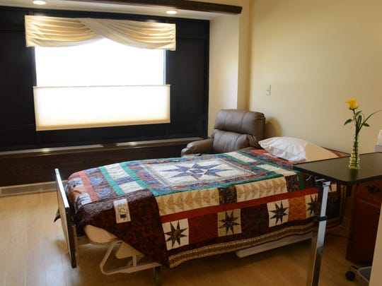 One of 10 rooms with beds and comfy chairs in the Mercy