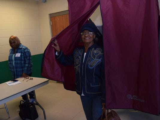 Vera M. Bonton casts her vote at the C7 Voting Precinct at Peabody Magnet High School. She and her husband Samuel Bonton voted in the presidential preference primaries held Saturday. To the left is polling commissioner Joanette Anderson.
