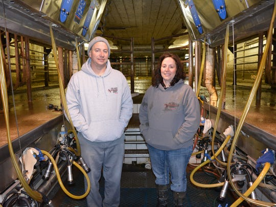 When Josh Salentine and his sister Michelle Kasten wanted to take over  the family farm, they combined their assets and formed an LLC.  Here they are in the milk parlor where the farm milks 160 cows.