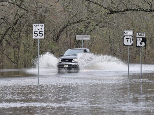 Despite barricades and high water warning signs, drivers still drove through the area of U.S. 71 and La. Highway 8 near Colfax.