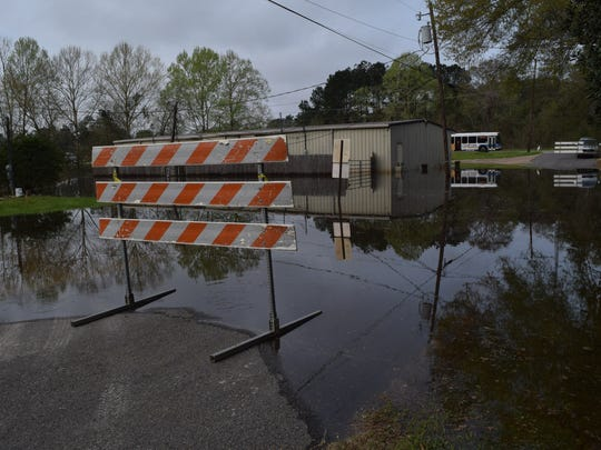 Water surrounds Robinson Family Mortuary and a neighborhood