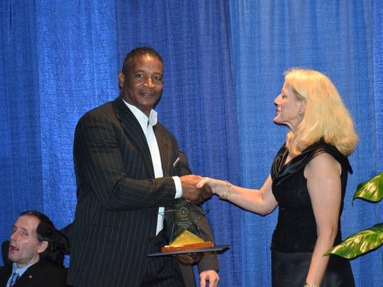 Doug Baldwin Sr. accepts award for his son, Doug Baldwin,
