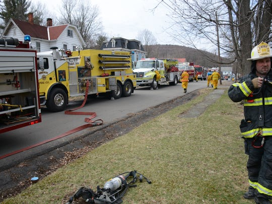 Officials on the scene of a house fire in Windsor Sunday.