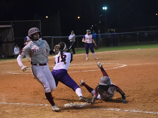Pineville's Hailee Wilkins (7, far right) safely jumps back to first after a flyball hit by Hanna Evers (13, far left) is caught by ASH's Briahna Bennett and thrown to ASH first baseman Sabrina Thiels (13) for an attempted double-play.