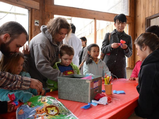 Visitors to the Binghamton Zoo at Ross Park Sunday for the annual event Eggstravaganza make Easter-themed crafts Sunday.