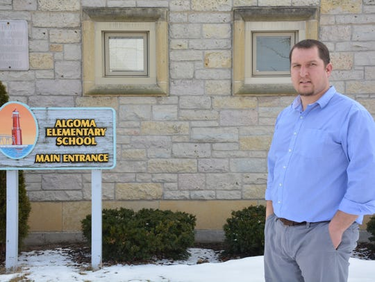 Algoma Superintendent. Nick Cochart stands in front
