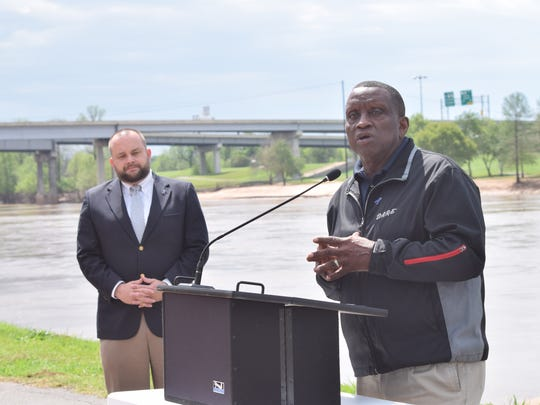 Pineville mayor Clarence Fields (right) speaks at a vigil marking the beginning of National Child Abuse Awareness Month. Wade Bond (left) is the executive director of the Rapides Children Advocacy Center, which held the vigil.