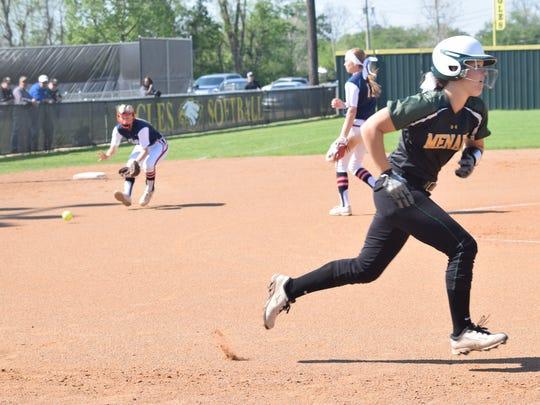 Menard's Abby Gwinn (3, right) hits a ground ball to North Desoto's third baseman Bayli Simon (3, left) and reaches first before Simon's throw.