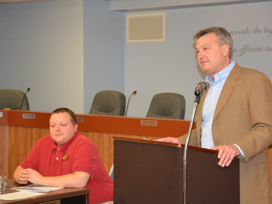 State representatives Scott Krug (left) and Joel Kitchens listen to residents' concerns about the Ahnapee River watershed.