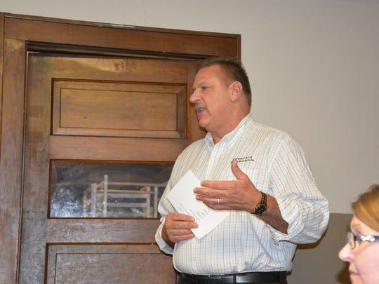 Lee Novak, village engineer, reviews plans for the Main Street Enhancement Project.