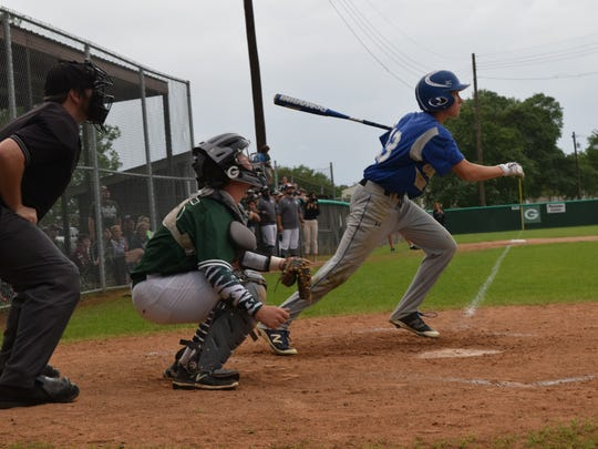 Oak Hill's Chase Gardner (13, right) bats against Grace Christian.