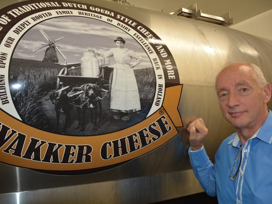 Johannes Wakker is using the photo of his Dutch grandmother on his milk delivery truck as well as the cheese store's new sign.