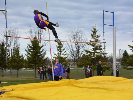 The Storm's Mitch Kudick soars over the 9-foot pole vault.