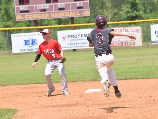 Grant High School's Steven Roberts (3, right) steals second against Tioga's Brady McGehee (8, left).