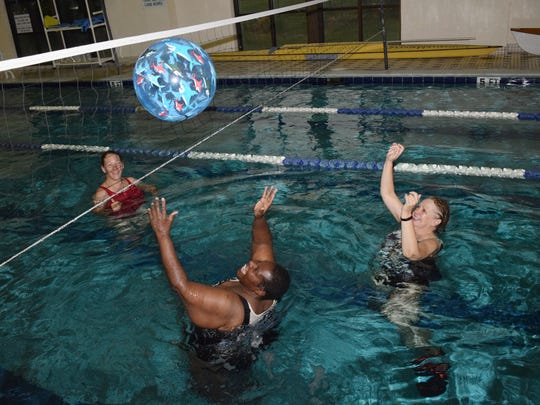 Priscilla Vinson (center, front) gets ready to hit the ball over the net while playing water volleyball with Sally Cooper (far right) and Jayne Rhodes in the lap pool at the Louisiana Athletic Club in Pineville. The class plays at 8 a.m. on Wednesdays. On the last Friday of each month, a two-hour tournament is held. The class is more about fun and socialization than competition.