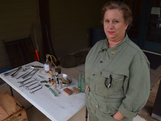 Portraying a World War II-era nurse, Juli Price shows an exhibit of some of the instruments that would have been used by military nurses serving in World War II. Price was participating in the Louisiana History Timeline event held Saturday at Forts Randolph & Buhlow State Historic Site in Pineville.