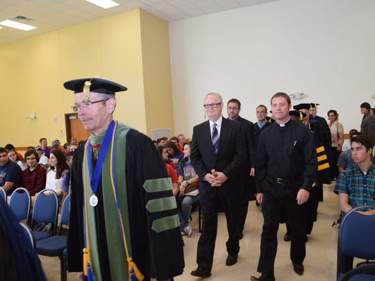 LSUA Chancellor Dan Howard (front) walks in with guest speaker Jim Clinton (back, left), president and CEO of the Central Louisiana Economic Development Alliance, and the Rev. Charlie Ray for the second annual new student convocation held in the fall 2015 semester at the university.