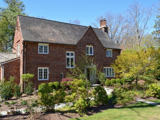 This Westfield Tudor-style home has a pool, and a cabana  on its professionally landscaped grounds.