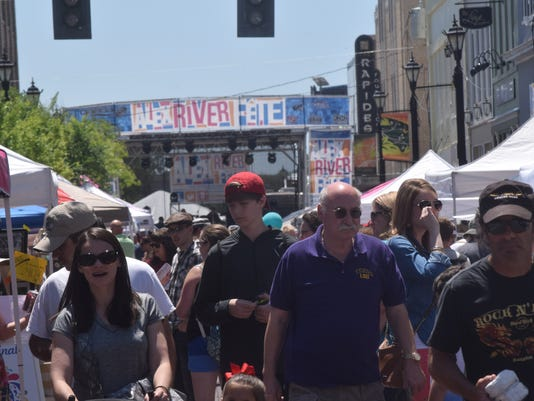 Crowds walk along Third Street in downtown Alexandria during Alex RiverFete held Saturday.