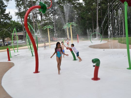 Nayah Mayroca (foreground) and other children enjoy a trial run at the new splash pad at Kees Park in Pineville. The $325,000 splash pad will open at 9 a.m. Friday, May 20.