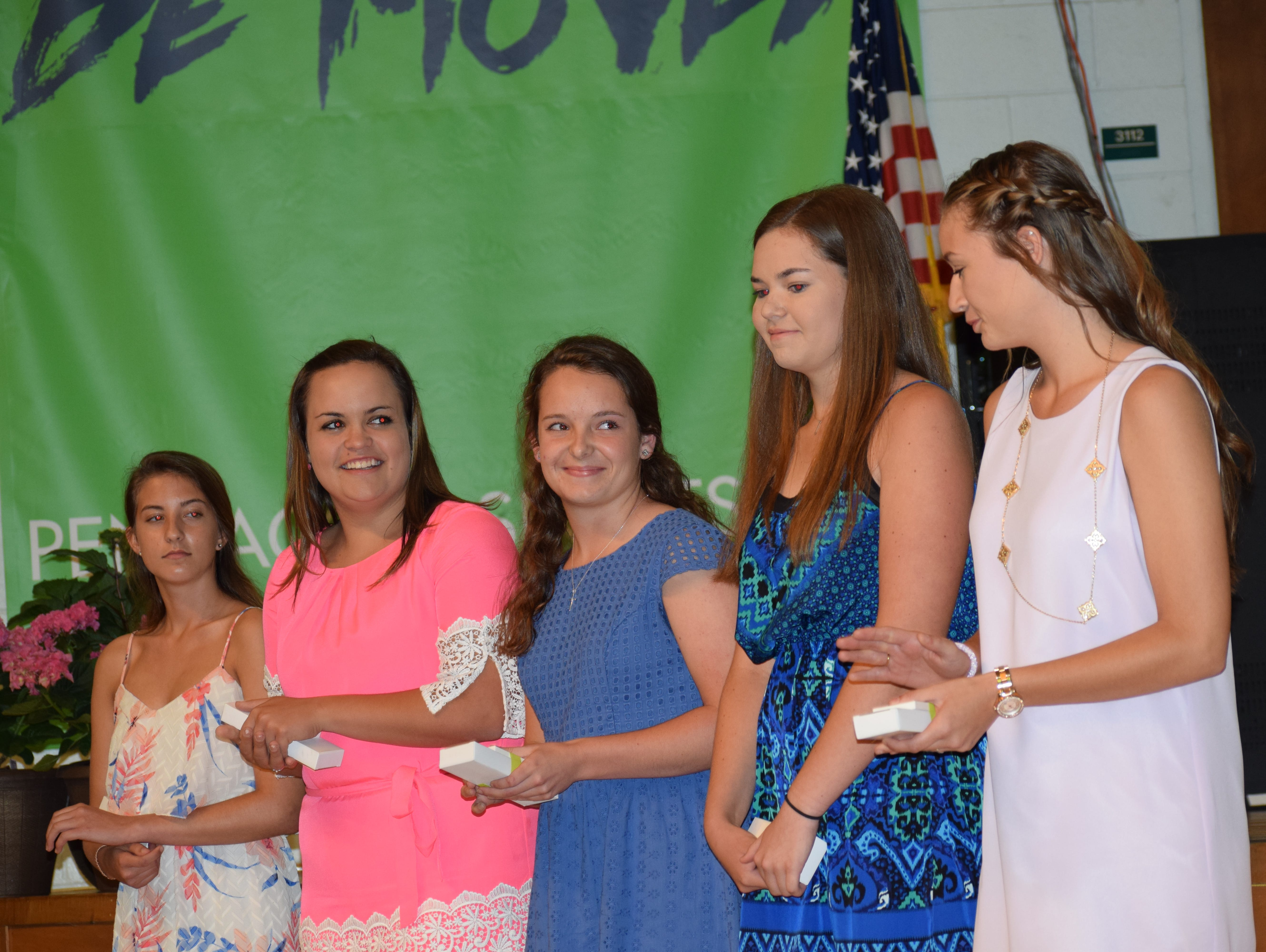 Catholic High's Abby Herrmann (second from right) gets congratulated by fellow nominees as she hears she has won the girls golf award at the 37th annual Pensacola Sports Senior Scholar-Athlete Awards Banquet at Olive Baptist Church.
