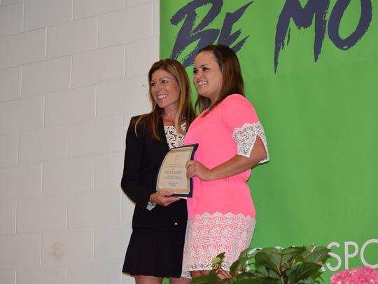 Milton High's Chloe Dawson is awarded the Dr. Alec Kessler Memorial Scholarship in honor of former physician, basketball player at Tuesday's Pensacola Sports Scholar Athlete Awards Banquet.