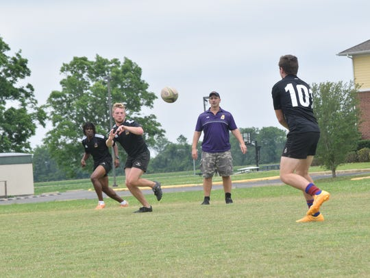 LSUA rugby coach Boyd Lejeune (back, second from right)