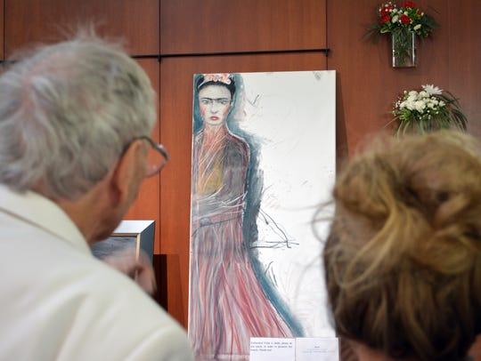 Pierre Henri Matisse, left, comments on Rosa Keck's