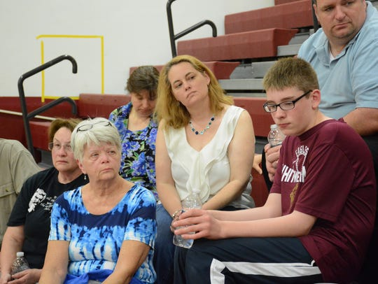 Amy Timmins, center, with her son Josh Timmins, right,