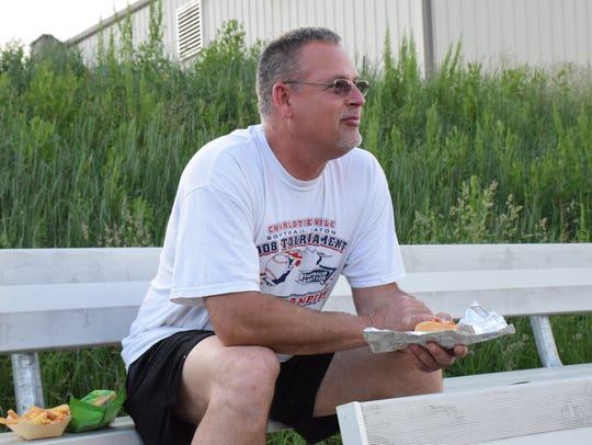 Floyd Reeder of Linville watches the teams warm up