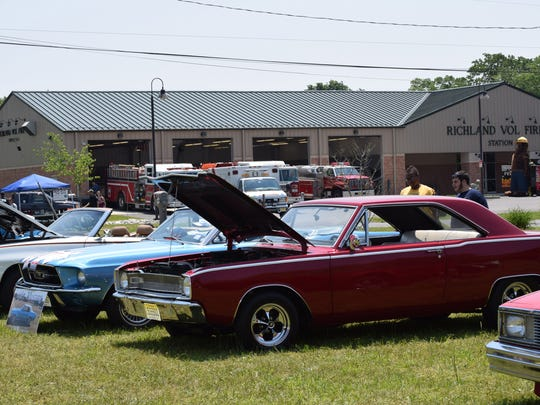 Tamara Allen and Matthew Maurone, both of Richland, check out the cars displayed during the South Jersey Mustang Car Show at the Richland Village Festival on May 28. Photo/Jodi Streahle