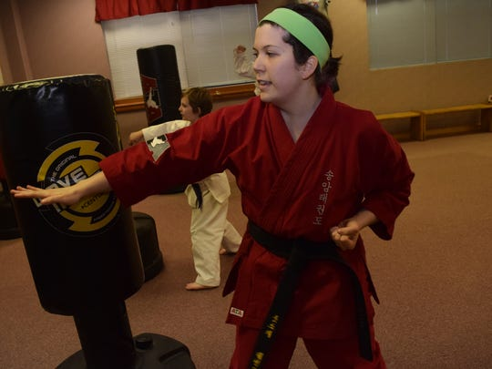 Linzey Guillot, one of the instructors at Master Rousseau's Taekwondo, located on Kegleman Blvd. on England Airpark, took up taekwondo five and a half years ago after she attended a bully prevention seminar held at Master Rousseau's. Taekwondo, she said, gave her a way to overcome her shyness and gain confidence and self-respect.