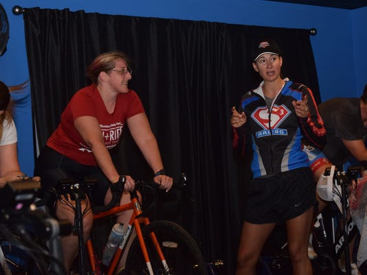 Triathlete Lua Walter (left), gets instruction from Stacey McMickens, owner of FiXX Cycling and S3 Training, Thursday morning as she trains on a Compu Trainer. McMickens offers individualized coaching for endurance athletes.